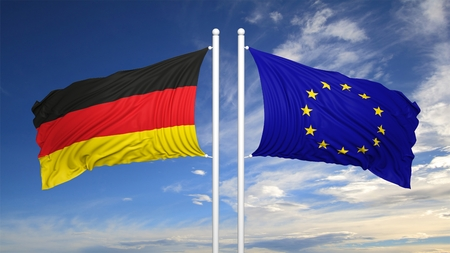 coalition: EU and German flags against of blue sky
