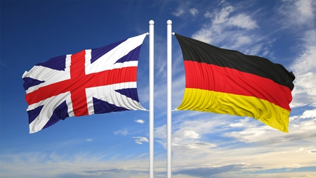 coalition: German and British flags against of blue sky
