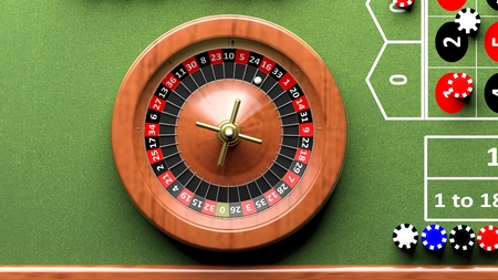 poker chip: Roulette wheel on green table, poker chips.From above