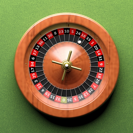 ardour: Close-up of roulette wheel on green background.From above Stock Photo