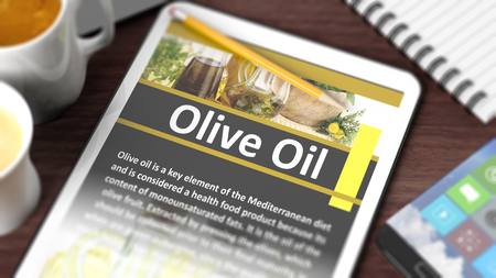 digital tablet: Tabletop with various objects focused on tablet with Olive Oil  content on screen