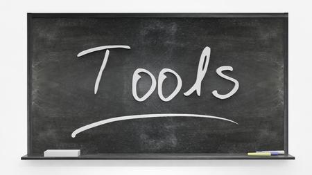 written: Tools written on blackboard Stock Photo