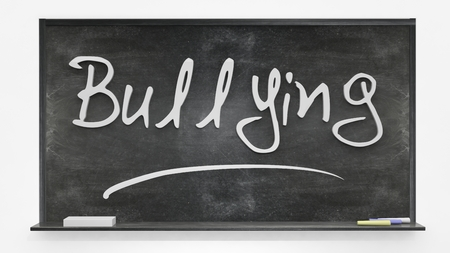 written: Bullying written on blackboard
