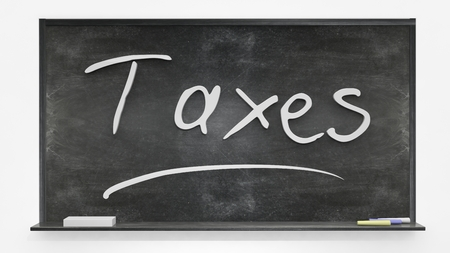 assess: Taxes written on blackboard