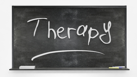 written: Therapy written on blackboard