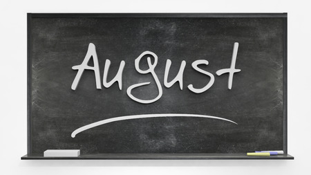 august: August written on blackboard Stock Photo