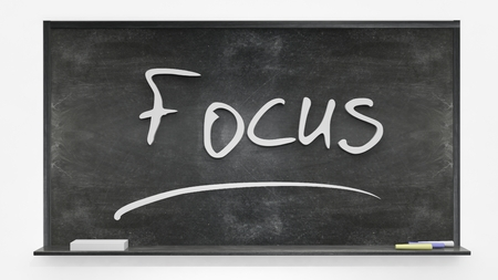focus: Focus written on blackboard Stock Photo