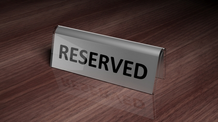 silver reflection: Silver glossy reservation sign on wooden surface with reflection Stock Photo