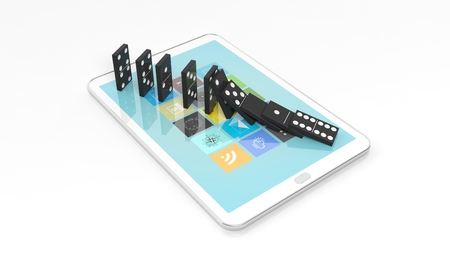 technology symbols metaphors: Black domino tiles falling in a row on tablet screen, isolated on white Stock Photo