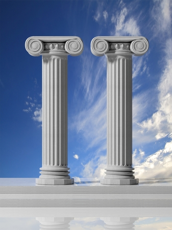 column: Two ancient pillars with blue sky background. Stock Photo