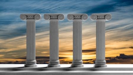 일몰 하늘 배경 가진 4 개의 고 대 기둥입니다.