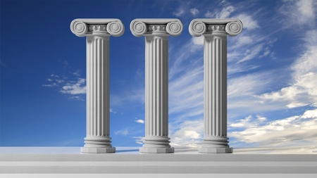 Three ancient pillars with blue sky background.