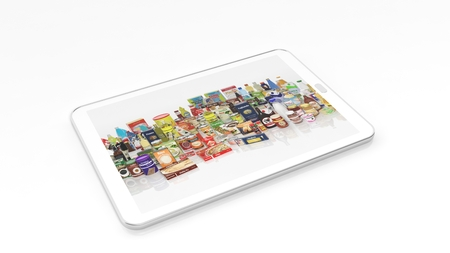 Supermarket grocery products on tablet screen, isolated on white background. Reklamní fotografie