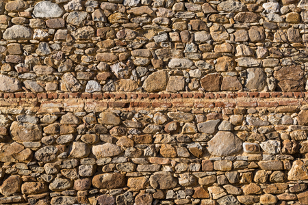 wall texture: Old weathered stone wall texture Stock Photo
