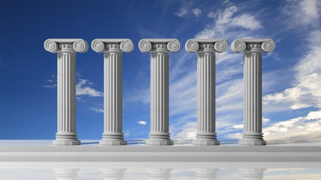 Five ancient pillars with blue sky background. Stock Photo