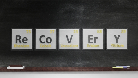 Periodic table of elements symbols used to form word Recovery, on blackboard