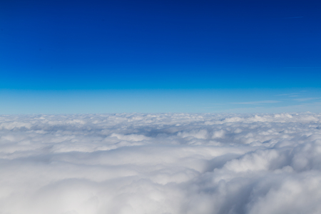 top of the world: Blue horizon and white clouds, aerial shot