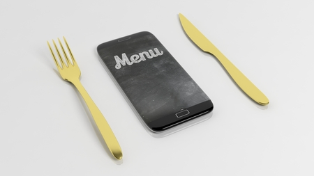 order delivery: Golden fork and  knife with smartphone with Menu written on screen, isolated on white background. Stock Photo