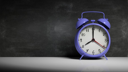 back in an hour: Retro blue alarm clock with blackboard and copy-space