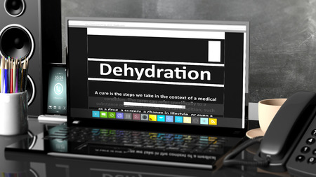 dehydration: Laptop with Dehydration  information on screen, on desktop with office objects.