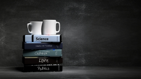 Stack of books with various subjects and two cups of coffee, with blackboard background. Stock Photo - 52312616