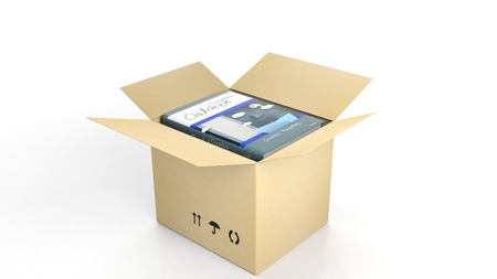 children background: Book Creative Children with illustrated cover inside an open cardboard box, on white background. Stock Photo