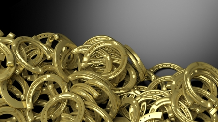 copyspace: Golden horseshoe pile abstract background with copy-space