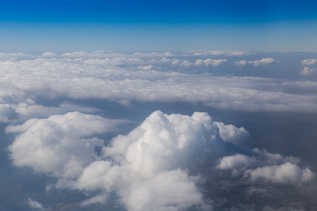 view through: Land view through clouds, aerial photography. Stock Photo
