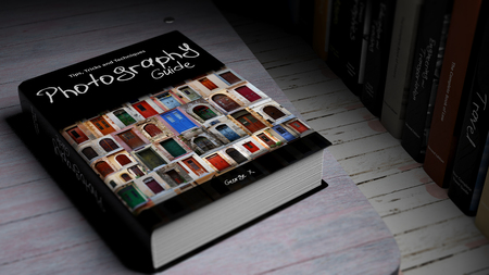 hardcover: Hardcover book on Photography with illustration on cover, on wooden surface.