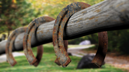 rusty: Old rusty horseshoes, set on wooden fence
