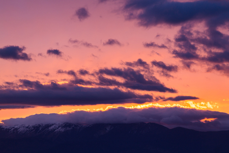 majestic mountain: Majestic vivid sunset with clouds over mountain rage