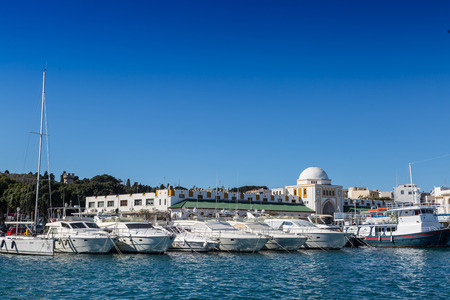 rhodes: Harbor buildings and boats, Rhodes Greece Stock Photo