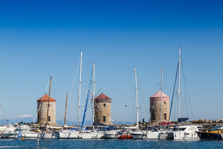 Harbor buildings and boats, Rhodes Greece Stock Photo