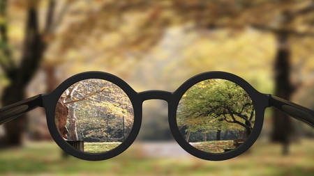 myopia: Closeup on eyeglasses with focused and blurred landscape view. Stock Photo