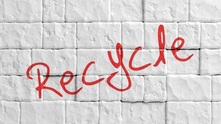 brick earth: White painted brick wall with red Recycle text graffiti