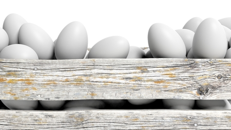 old container: White eggs in old wooden container closeup, isolated on white. Stock Photo