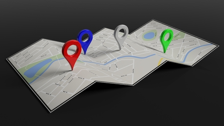 folded paper: Folded paper map with colorful pointers, isolated on black background.