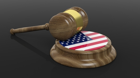 accuse: Court hammer with American flag on black background