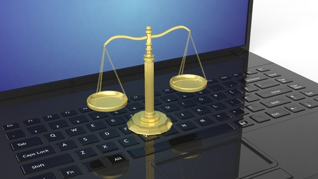 justice: Close-up of three-dimensional golden scales of justice of laptop keyboard