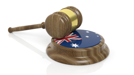 judiciary: Wooden court hammer and Australian flag on white background