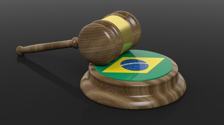 law of brazil: Court hammer and flag of Brazil on black background Stock Photo