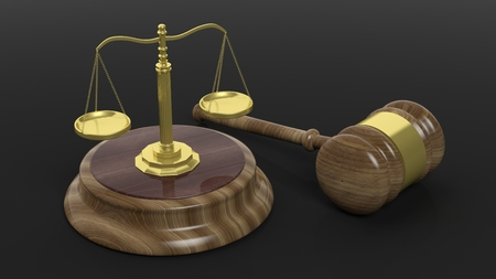 justice hammer: Golden scales of justice with wooden court hammer on black background