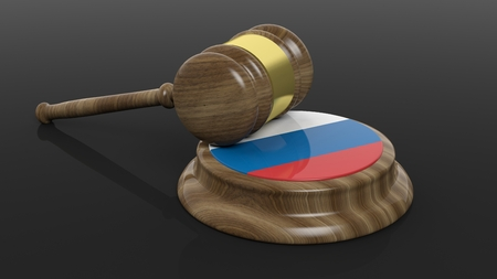 criminal case: Russian flag with court hammer on black background