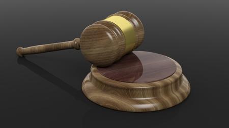 criminal case: Close-up of wooden court hammer on black background
