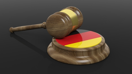 accused: Court hammer with flag of Germany on black background