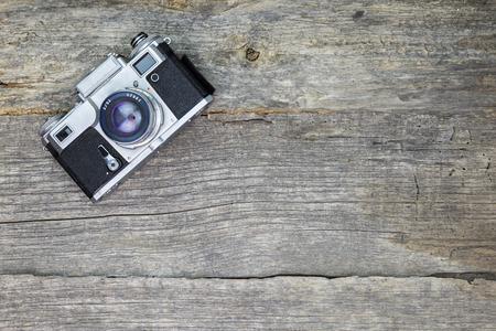 wooden surface: Old analog camera on wooden surface Stock Photo