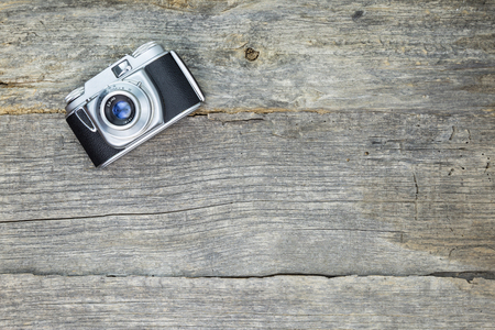 analog: Old analog camera on wooden surface Stock Photo