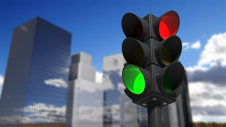 signals: Traffic lights on green and red, with city street view background