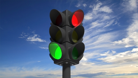 traffic regulation: Traffic lights on green and red, with blue sky background