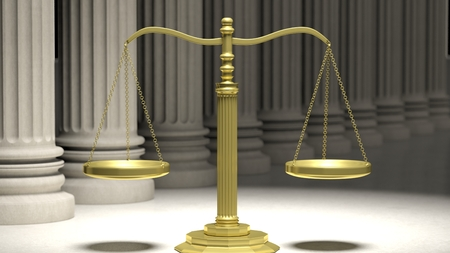 justice scale: Golden scale of justice with ancient pillars in background.